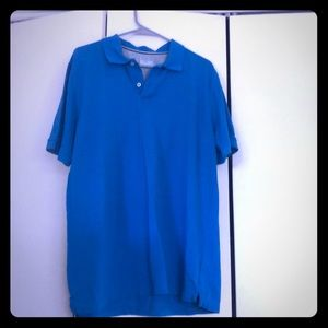 Blue polo shirt.